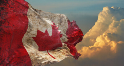 Retro,Flag,Of,Canada,With,Grunge,Texture,Waving,In,The